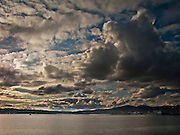 A weather system moving through the Puget Sound is putting on a show over Sinclair Inlet with the Puget Sound Naval Shipyard at Bremerton, WA on the right side of the image.