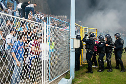 Fans fightin with police during football match between HNK Rijeka and HNK Hajduk Split in 11th Round of Prva Hrvaska Nogometna Liga MaxTV 2013/14 on September 28, 2013 in Stadion Kantrida, Rijeka, Croatia. (Photo By Urban Urbanc / Sportida.com)