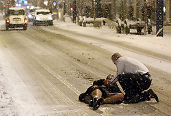 """© under license to London News Pictures. 18/12/2010 as snow blizzards hit - and despite  sub-zero temparatures - revellers carry on through """"Mad Friday"""" night"""