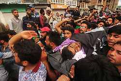 May 5, 2018 - Srinagar, Jammu and Kashmir, India - People carry the dead body of a protester who was ran over by police vehicle during anti-India clashes in Srinagar the summer of Indian controlled Kashmir on May 05, 2018. Four people including a protester and three rebels were killed during a gun-battle between rebels and Indian forces in Chattabal area of Srinagar. Massive clashes erupt across Srinagar after the news about the trapping of rebels and killing of protester spread across the city. Police fired teargas canisters, pellets, stun grenades and rubber coated bullets to disperse the angry crowd. (Credit Image: © Faisal Khan via ZUMA Wire)