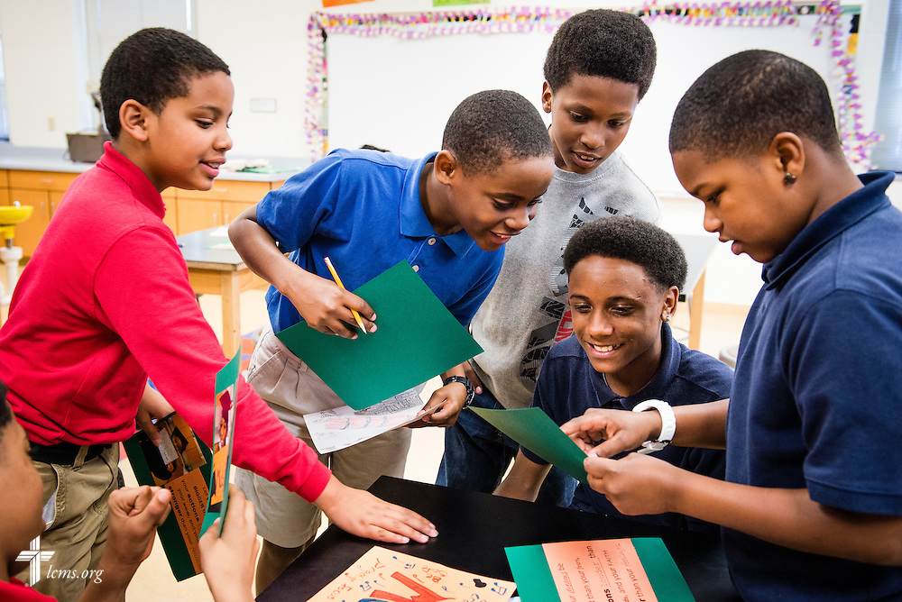 (L-R) Shaheem, Kenneth, Shawntrell, Ramon, and Marqual compare photographs of themselves during class at Mount Calvary Lutheran School on Wednesday, May 28, 2014, in Milwaukee, Wis. LCMS Communications/Erik M. Lunsford