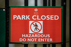 © Licensed to London News Pictures. 09/02/2020. London, UK. Richmond Gate in Richmond Park closes its gates. Storm Ciara hits London and the South East as Richmond Park and 7 other Royal Parks close their gates this morning as weather experts predict stormy weather with very high winds and heavy rain for Sunday. Photo credit: Alex Lentati/LNP