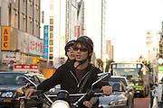 young couple on motocycle Tokyo Japan