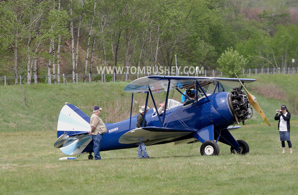 Wurtsboro, NY - People gather around a 1941 Waco UPF-7that was taking people on rides at the grand reopening of Wurtsboro Airport on May 11, 2008.
