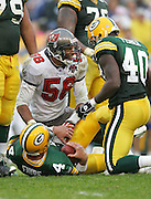 GREEN BAY, WI - SEPTEMBER 25:  Linebacker Ryan Nece #56 of the Tampa Bay Buccaneers smiles after sacking quarterback Brett Favre #4 of the Green Bay Packers at Lambeau Field on September 25, 2005 in Green Bay, Wisconsin. The Buccaneers defeated the Packers 17-16. ©Paul Anthony Spinelli *** Local Caption *** Ryan Nece;Brett Favre