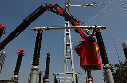 AMAY, BELGIUM - AUGUST-26-2003 - Construction of electric power substation. (PHOTO © JOCK FISTICK).