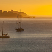Sunrise with sailboats at Cabo San Lucas Bay.