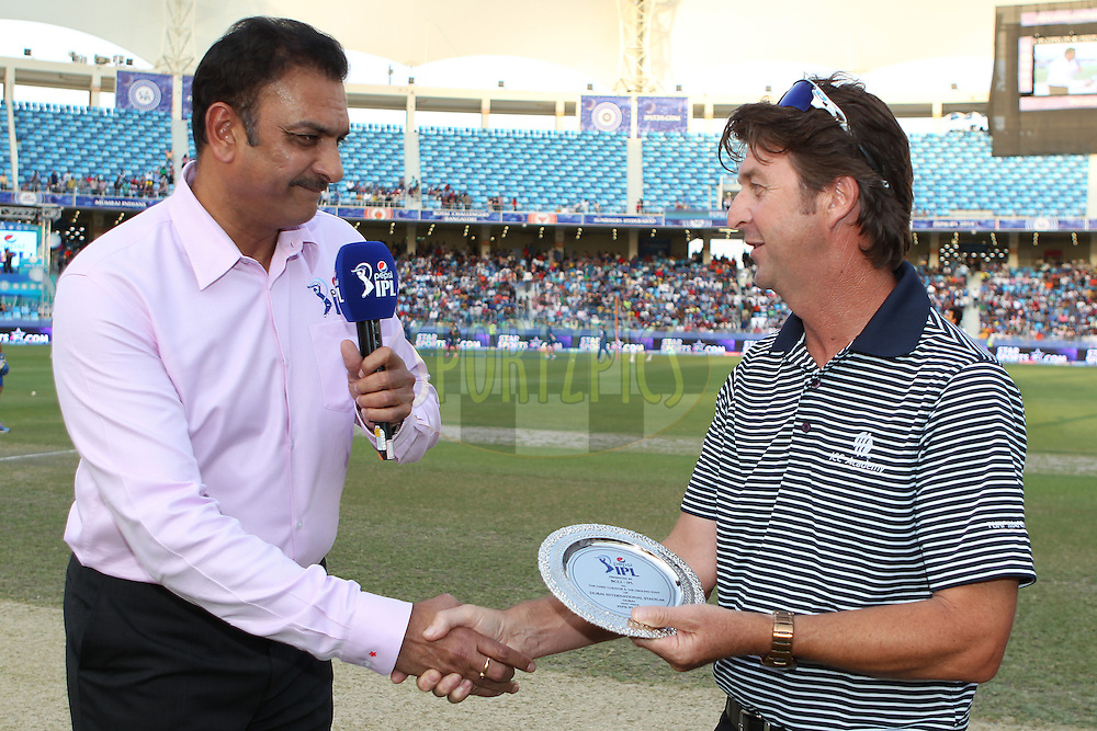 Ravi Shastri presents Chief Curator Anthony Hemming with a commemorative plate during match 20 of the Pepsi Indian Premier League Season 2014 between the Mumbai Indians and the Sunrisers Hyderabad held at the Dubai International Stadium, Dubai, United Arab Emirates on the 30th April 2014<br /> <br /> Photo by Ron Gaunt / IPL / SPORTZPICS