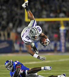 Oct 14, 2010; Lawrence, KS, USA; Kansas State Wildcats wide receiver Aubrey Quarles (89) goes airborne over Kansas Jayhawks safety Olaitan Oguntodu (44) in the first half of the game at Memorial Stadium. Mandatory Credit: Denny Medley-US PRESSWIRE