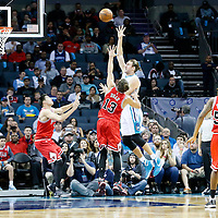 03 November 2015: Charlotte Hornets forward Spencer Hawes (00) goes for the layup over Chicago Bulls center Joakim Noah (13) during the Charlotte Hornets  130-105 victory over the Chicago Bulls, at the Time Warner Cable Arena, in Charlotte, North Carolina, USA.