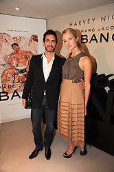 MARC JACOBS and FLORRIE ARNOLD at a party to celebrate the launch of Bang a new male fragrance by Marc Jacobs held at the Fith Floor Restaurant, Harvey Nichols, Knightsbridge, London on 22nd July 2010.