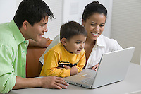Family Using Laptop close up