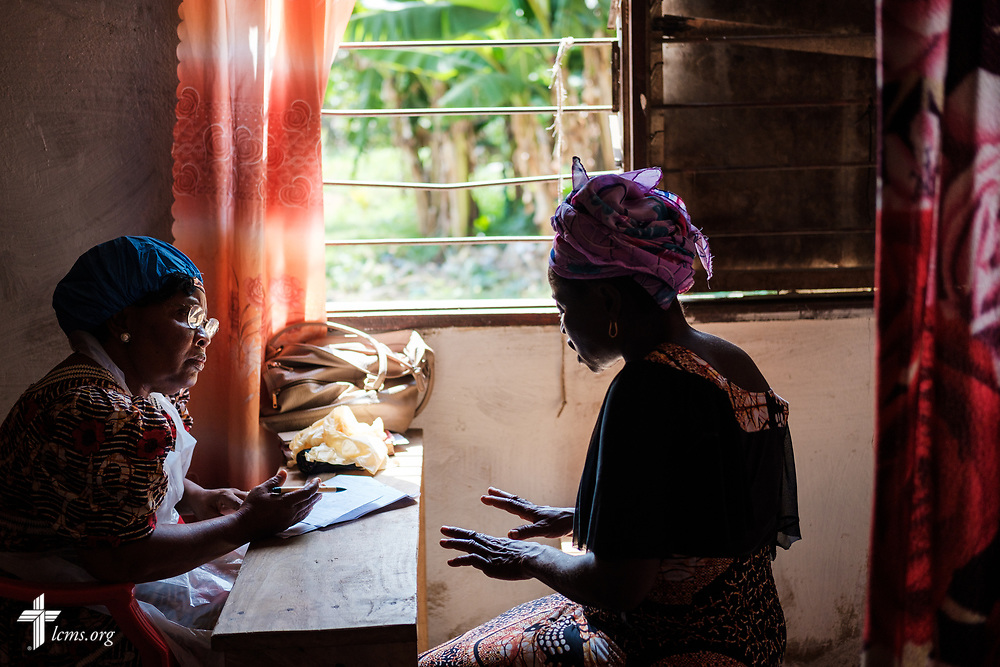 A patient explains her maladies on the fifth day of the LCMS Mercy Medical Team on Friday, May 11, 2018, in the Yardu village outside Koidu, Sierra Leone, West Africa. LCMS Communications/Erik M. Lunsford