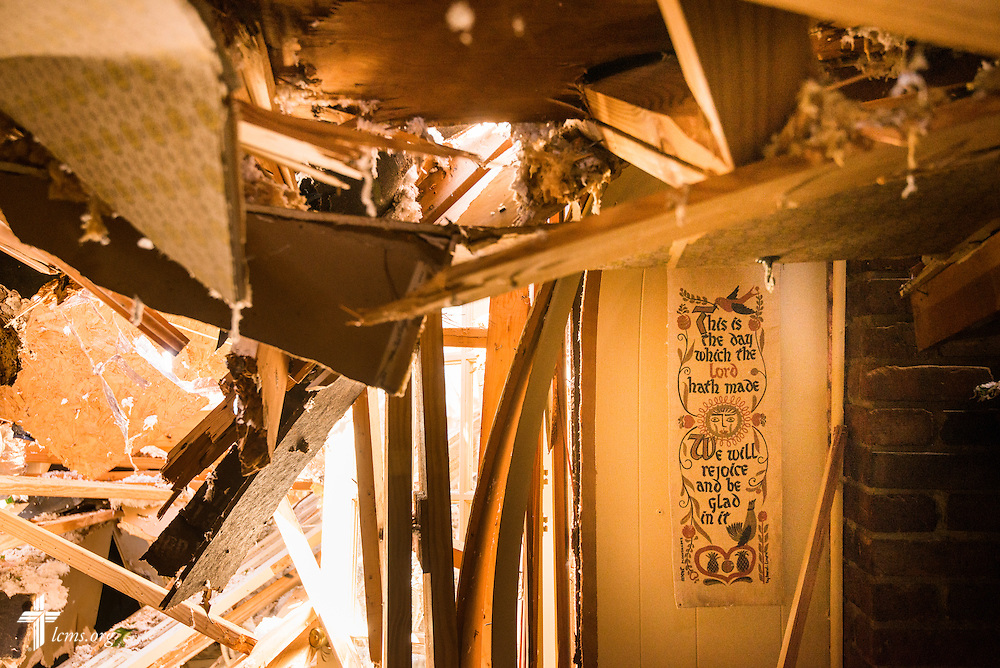 A banner hangs amongst damage in the Dufford house in Tupelo, Miss., on Friday, May 2, 2014. A tornado ravaged the community earlier in the week. LCMS Communications/Erik M. Lunsford
