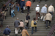 people walking up and down large stairs