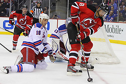 Jan 31; Newark, NJ, USA; New Jersey Devils right wing Dainius Zubrus (8) plays the puck while being defended by New York Rangers defenseman Marc Staal (18)  during the second period at the Prudential Center.