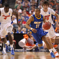 Mar 17, 2011; Tampa, FL, USA; UC Santa Barbara Gauchos guard Justin Joyner (11) drives with the ball against the Florida Gators during second half of the second round of the 2011 NCAA men's basketball tournament at the St. Pete Times Forum. Florida defeated UCSB 79-51.  Mandatory Credit: Derick E. Hingle