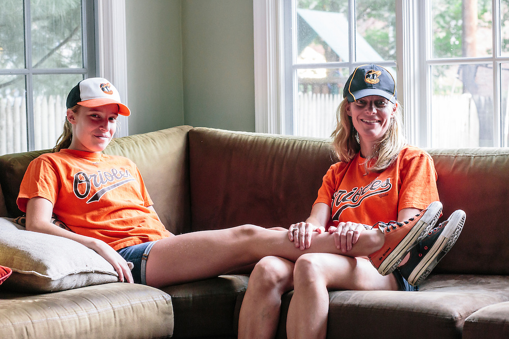 "Meredith Case Ellison, 13, left, and her mom Lauren Case, who live in Washington D.C. have been lifelong Orioles fans. Meredith even made custom orange and black Converse shoes with the slogan ""Go Orioles"" stitched into the side."