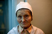 Nina Merzlikina, 75, has worked for 35 years as a nurse at the hospital in a village outside Vorkuta..Vorkuta is a coal mining and former Gulag town 1,200 miles north east of Moscow, beyond the Arctic Circle, where temperatures in winter drop to -50C. .Here, whole villages are being slowly deserted and reclaimed by snow, while the financial crisis is squeezing coal mining companies that already struggle to find workers..Moscow says its Far North is a strategic region, targeting huge investment to exploit its oil and gas resources. But there is a paradox: the Far North is actually dying. Every year thousands of people from towns and cities in the Russian Arctic are fleeing south. The system of subsidies that propped up Siberia and the Arctic in the Soviet times has crumbled. Now there?s no advantage to living in the Far North - salaries are no higher than in central Russia and prices for goods are higher.