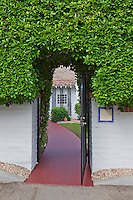 Open gate leading to bungalow