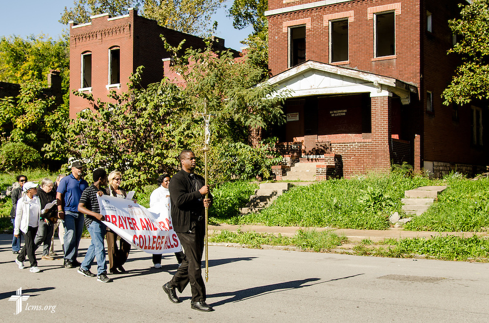 Chris Chandler, a third-year student at Concordia Seminary, St. Louis, leads a group during the LCMS Prayer & Praise Walk on Friday, Oct. 17, 2014, in the College Hill neighborhood of St. Louis. LCMS Communications/Frank Kohn