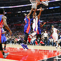 07 November 2016: Los Angeles Clippers forward Wesley Johnson (33) goes for the layup between `Detroit Pistons center Andre Drummond (0) and Detroit Pistons forward Marcus Morris (13) during the LA Clippers 114-82 victory over the Detroit Pistons, at the Staples Center, Los Angeles, California, USA.