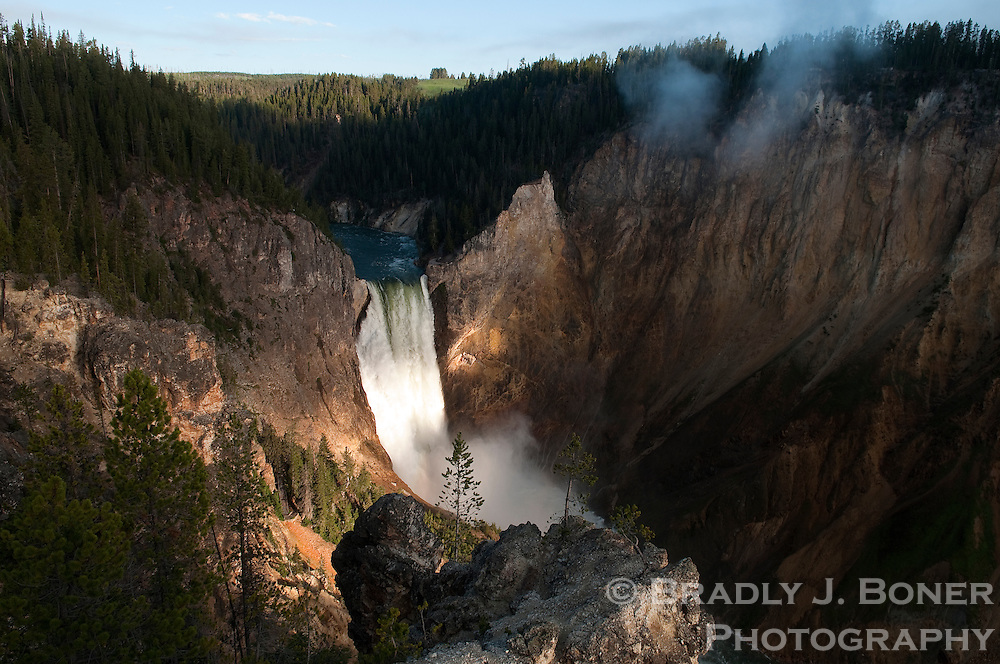 The Lower Falls of the Yellowstone River are illuminated by the first light of day Friday morning in Yellowstone National Park. The power of the great falls of the Yellowstone have been amplified by record snowfall and subsequent runoff in the region, making for river levels not seen in dozens of years.