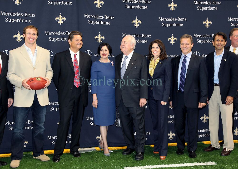 04 October 2011. New Orleans, Louisiana, USA.  <br /> NFL's New Orleans Saints announce a multi million dollar deal with Mercedes-Benz for naming rights on the Louisiana Superdome. Now the Mercedes-Benz Superdome. L/R Quarterback Drew Brees, Mercedes-Benz USA President and CEO Ernst Leib, Gayle Benson (wife of Tom), Saints owner Tom Benson, grand daughter, part owner and Saints VP Rita Benson Leblanc, Mercedes-Benz VP Marketing Stephen Cannon and Louisiana and Governor Bobby Jindal.<br /> Photos; Charlie Varley/varleypix.com