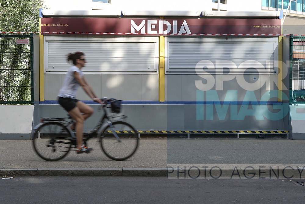 A woman cycles past the closed media ticket booth before the Serie A match at Stadio Grande Torino, Turin. Picture date: 20th June 2020. Picture credit should read: Jonathan Moscrop/Sportimage