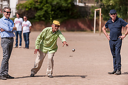 "© Licensed to London News Pictures. 05/06/2015.   London, UK. Jim Beach (centre), manager of the rock band, Queen, watched by Monty Python star, Eric Idle (right), takes part in ""Freddie for the Day"", by playing a special game of celebrity Pétanque, competing for the Londonaise 'Celebrity Pétanque Trophy', ahead of The Londonaise Pétanque festival this weekend in Barnard Park, Islington.  The festival will set a new precedent in the UK with 128 teams taking part in the main tournament.  The event also aims to raise funds for the Mercury Phoenix Trust to fight against AIDS worldwide. Photo credit : Stephen Chung/LNP"