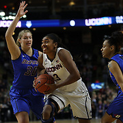 Morgan Tuck, UConn, drives to the basket past Megan Podkowa, (left), and Brittany Hrynko, DePaul, during the UConn Vs DePaul, NCAA Women's College basketball game at Webster Bank Arena, Bridgeport, Connecticut, USA. 19th December 2014