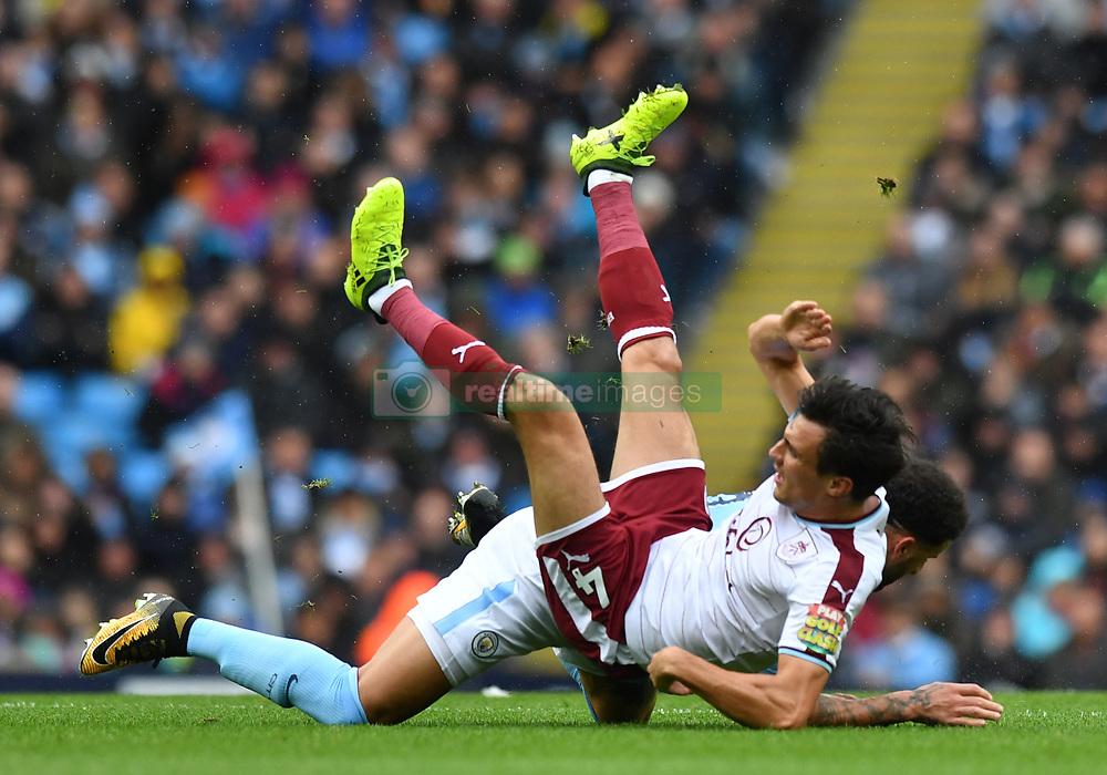 Manchester City's Kyle Walker (right) challenges Burnley's Jack Cork