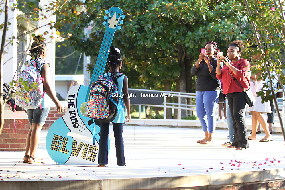 Lacey Donald, center right, and her freind, Candance Ball, grab a quick photo of their daughters before they leave their girls at Lawhon Elementary School for their first day of school on Thursday.