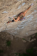 "Professional climber Emily Harrington climbing ""Hellion"" rated 13C, ""Superratic Crag,"" Ten Sleep Canyon Wyoming."