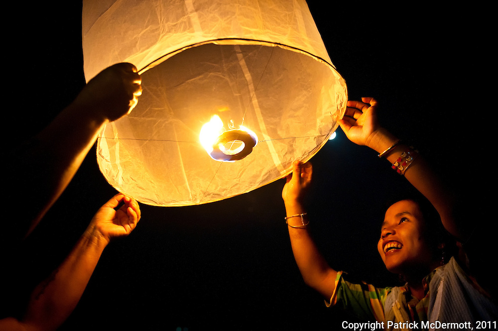 Revelers of the traditional Thai festival held on the full moon of the second month of the ancient Lanna Calender, Yi Peng, release paper laterns, into the sky in Chiang Mai, Thailand on Monday, Nov. 22, 2010. The ancient capital of the former Lanna kingdom, where now both Loi Krathong and Yi Peng are celebrated at the same time, result in paper lanterns being lit and floral boats floating on the waters.<br />  (Photo by Patrick D. McDermott, 2010)