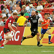 Captain DJ Forbes advances the ball in the All Blacks' 36-14 victory over Wales at the Singapore Sevens, Day 1, National Stadium, Singapore.  Photo by Barry Markowitz, 4/15/17