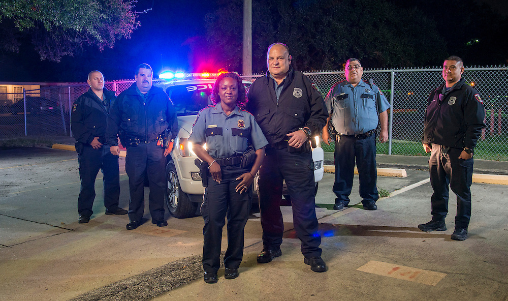 Members of the Houston ISD Police Department Members of HISD's Third Watch (L-R) Officer James Bibb, Officer David Sepulveda, Sgt. Denise Royal, Officer Quentin Wilson, Officer Freddy Vasquez and Officer Steve Olivos prepare to begin their overnight shift, November 6, 2013.