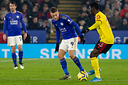 Jamie Vardy (9) & Ismaila Sarr (23) challenge for the ball during the Premier League match between Leicester City and Watford at the King Power Stadium, Leicester, England on 4 December 2019.