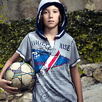 Male youth holding football