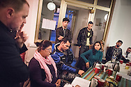The Rev. Markus Fischer, pastor of the Evangelisch-Lutherische St. Trinitatisgemeinde, a SELK Lutheran church in Leipzig, Germany, leads a Bible study for Iranian and other refugees on Friday, Nov. 13, 2015, near the church in Leipzig. LCMS Communications/Erik M. Lunsford