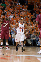 Virginia Cavaliers point guard Sean Singletary (44) fires up the crowd as Florida State Seminoles forward Al Thornton (12) signals the FSU offense.  The Virginia Cavaliers Men's Basketball Team defeated the Florida State Seminoles 73-70 at the John Paul Jones Arena in Charlottesville, VA on February 17, 2007.