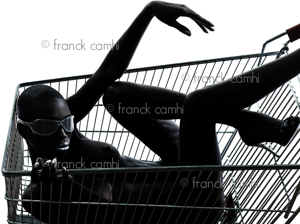 one beautiful black african naked woman sitting inside in a caddy shopping cart in studio isolated on white background