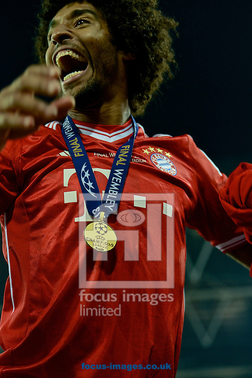 Picture by Ian Wadkins/Focus Images Ltd +44 7877 568959.25/05/2013.Dante of Bayern Munich celebrates after winning the UEFA Champions League match at Wembley Stadium, London..