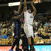 ORLANDO, FL - DECEMBER 31:  Justin McBride #34 of the UCF Knights shoots the ball during an NCAA basketball game against the Tulsa Golden Hurricane at the CFE Arena on December 31, 2014 in Orlando, Florida. (Photo by Alex Menendez/Getty Images) *** Local Caption *** Justin McBride