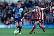Alex Pattison of Wycombe Wanderers on the attack during the EFL Sky Bet League 1 match between Wycombe Wanderers and Sunderland at Adams Park, High Wycombe, England on 19 October 2019.