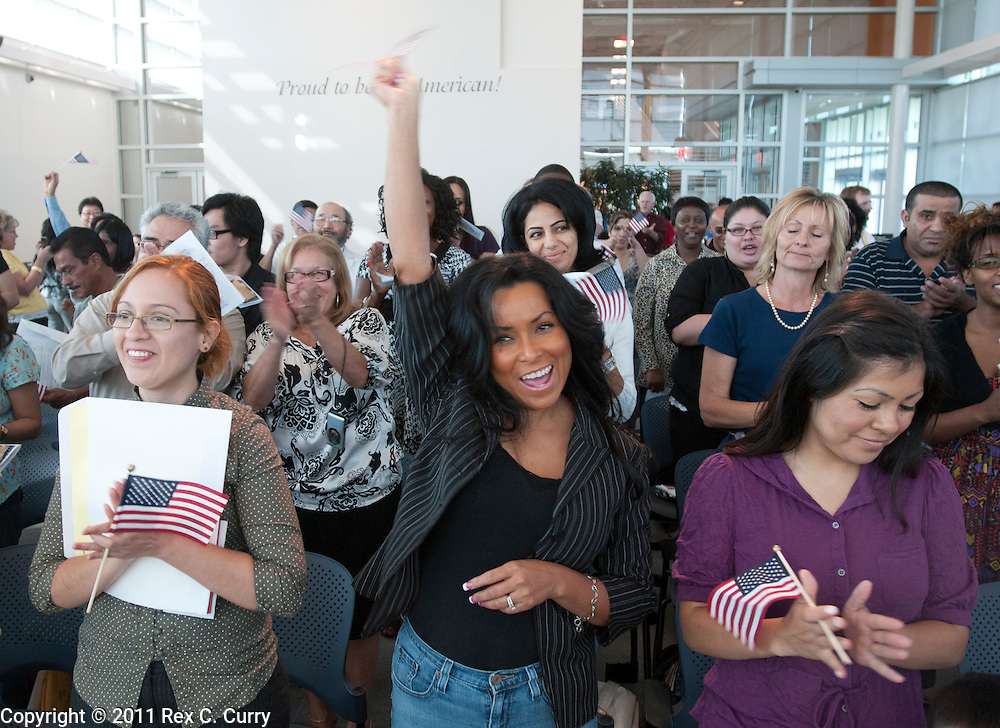 Avelina Hayes, center, from Mexico, celebrates her new citizenship status during a naturalization ceremony at the U.S. Citizenship and Immigration office in Irving on June 30, 2011. 27 people from Mexico became U.S. citizens.
