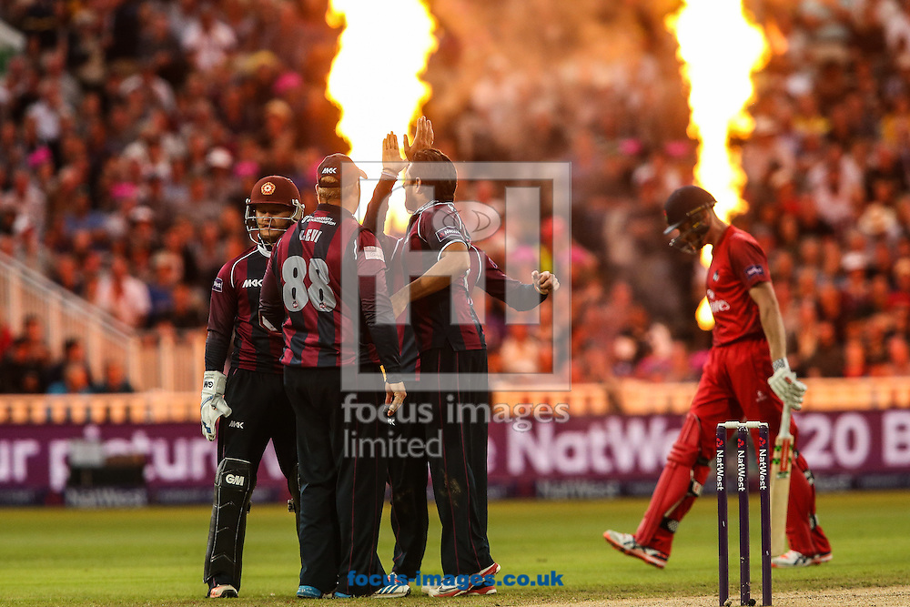 James Faulkner of Lancashire Lightning (right) walks off after being dismissed, caught Richard Levi of Northants Steelbacks (2nd left) bowled Shahid Afridi of Northants Steelbacks  (centre) during the Natwest T20 Blast Final at Edgbaston, Birmingham<br /> Picture by Andy Kearns/Focus Images Ltd 0781 864 4264<br /> 29/08/2015