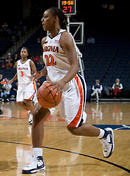 Virginia guard Monica Wright (22) dribbles up court against Davidson.  The Virginia Cavaliers women's basketball team defeated the Davidson Wildcats 83-68 at the John Paul Jones Arena in Charlottesville, VA on December 20, 2007.