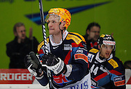 Kloten Flyers forward Tommi Santala (C) and Matthias Bieber (R) celebrate with their fans a 3-2 victory during overtime in the ice hockey game five of the Swiss National League A Playoff Quarterfinal between Kloten Flyers and ZSC Lions held at the Kolping Arena in Kloten, Switzerland, Tuesday, March 8, 2011. (Photo by Patrick B. Kraemer / MAGICPBK)