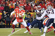 Jan 20, 2019; Kansas City, MO, USA; Kansas City Chiefs quarterback Patrick Mahomes (15) scrambles with the football during the AFC Championship game at Arrowhead Stadium. The Patriots defeated the Chiefs 37-31 in overtime to advance to their fifth Super Bowl in eight seasons. (Robin Alam/Image of Sport)